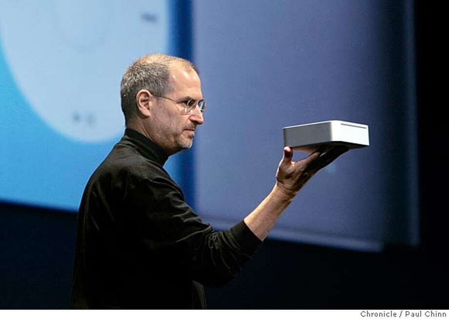 macworld12_100_pc.jpg  Steve Jobs shows off Apple's new Mac Mini computer. Apple CEO Steve Jobs unveiled the new Mac Mini desktop computer and the iPod Shuffle during his keynote speech at the 2005 Macworld show on 1/11/05 in San Francisco, CA.  PAUL CHINN/The Chronicle Ran on: 01-12-2005  Steve Jobs shows off the Mac Mini, above, the small version of Apple's desktop computer introduced along with the iPod Shuffle, below. MANDATORY CREDIT FOR PHOTOG AND S.F. CHRONICLE/ - MAGS OUT Photo: PAUL CHINN