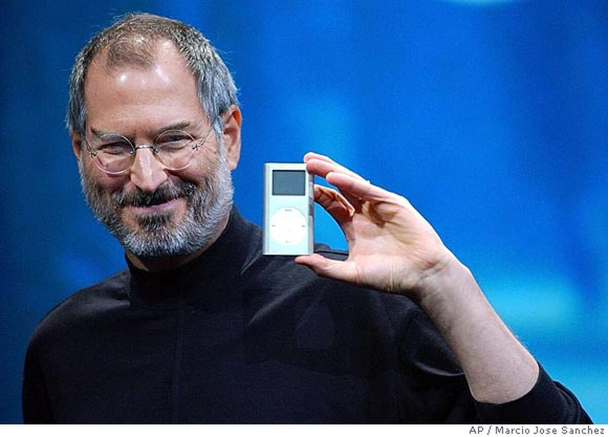 Apple CEO Steve Jobs displays his company's new product, the Mini-Ipod, at the Macworld Conference and Expo in San Francisco, Tuesday, Jan. 6, 2004. (AP Photo/Marcio Jose Sanchez) Ran on: 07-30-2004 Ran on: 12-15-2004 Steve Jobs Ran on: 12-15-2004 Steve Jobs Ran on: 12-28-2004 Jobs Ran on: 01-10-2005 Steve Jobs, Apples CEO, shows off the iPod Mini at last years Macworld. Ran on: 01-10-2005 Ran on: 01-10-2005 Ran on: 01-10-2005 BookReview#BookReview#Chronicle#05-22-2005#ALL#2star#e4#0422223639
