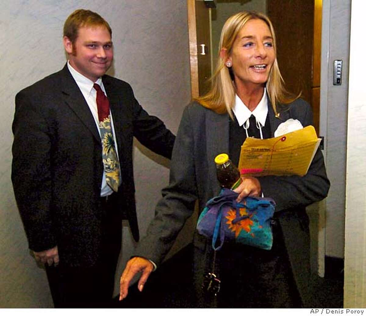 Candidate for San Diego Mayor, Donna Fyre, right, comes out of her office before reading a statement in reaction to the decision in Superior Court in San Diego, Monday, Nov. 22, 2004. A retired judge refused Monday to intervene in the city's mayoral election, where Mayor Dick Murphy has claimed victory over Fyre, a maverick city councilwoman who mounted a surprising write-in bid. (AP Photo/Denis Poroy) Metro#Metro#Chronicle#11/23/2004#ALL#5star#b2#0422481267