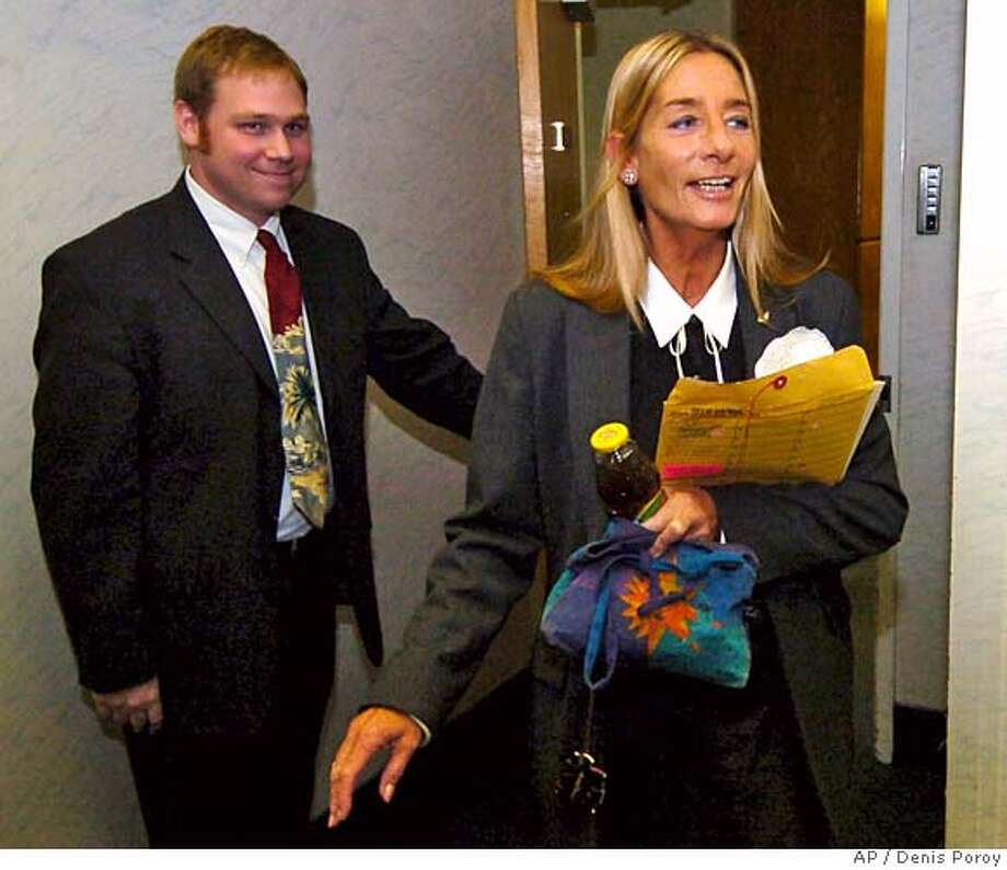 Candidate for San Diego Mayor, Donna Fyre, right, comes out of her office before reading a statement in reaction to the decision in Superior Court in San Diego, Monday, Nov. 22, 2004. A retired judge refused Monday to intervene in the city's mayoral election, where Mayor Dick Murphy has claimed victory over Fyre, a maverick city councilwoman who mounted a surprising write-in bid. (AP Photo/Denis Poroy) Metro#Metro#Chronicle#11/23/2004#ALL#5star#b2#0422481267 Photo: DENIS POROY