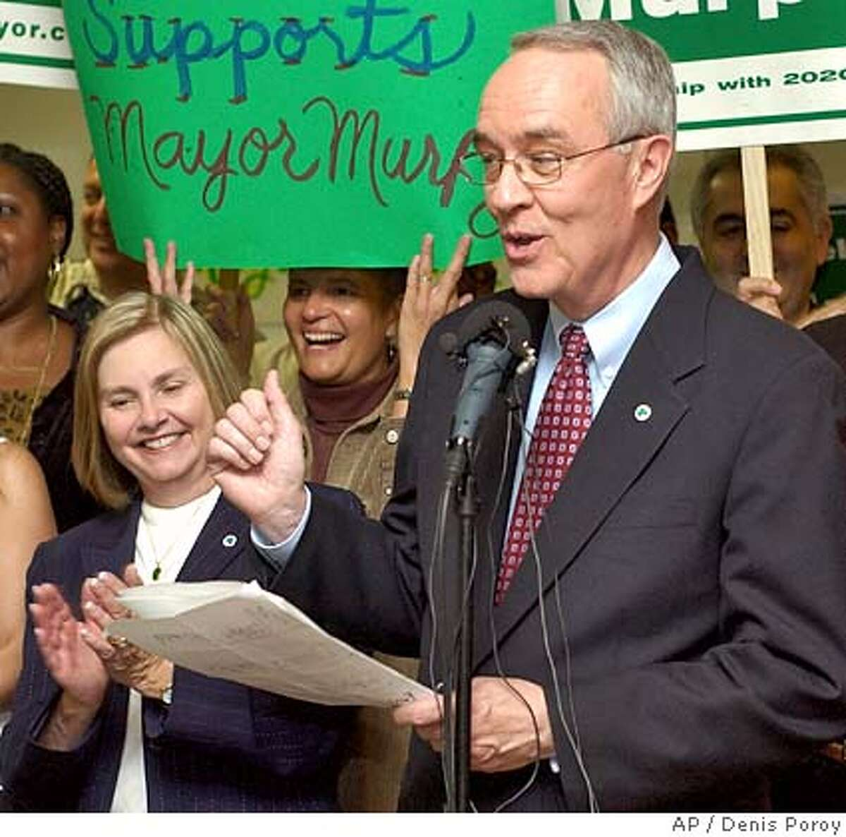 San Diego Mayor Dick Murphy, right, speaks as his wife Jan Murphy, left, looks on at a news conference Friday Nov. 19, 2004, in San Diego, announcing victory over his opponents, write-in candidate Donna Frye and Ron Roberts, in the San Diego mayors race. Murphy made his announcement after the San Diego registrar of voters finished the vote count with Murphy in the lead. His campaign still faces lawsuits challenging the election. (AP Photo/Denis Poroy) Metro#Metro#Chronicle#11/23/2004#ALL#5star#b2#0422476270