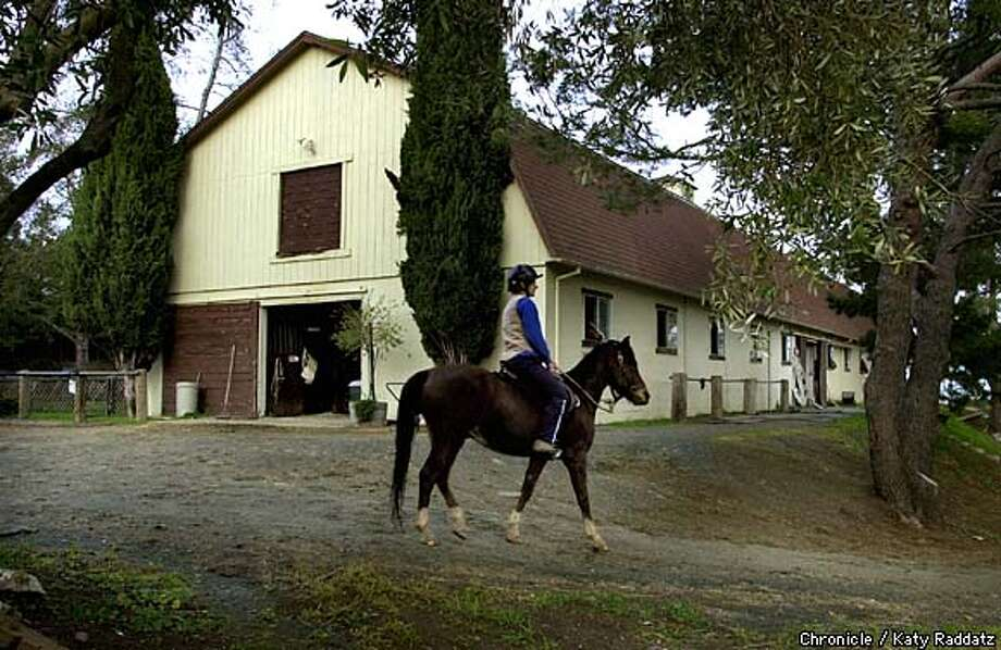 "PHOTOS BY KATY RADDATZ--THE CHRONICLE  Westwind Barn in Los Altos Hills has been saved by Bay Area Barns and Trails, which helps preserve publicly accessible barns, stables, trails, pastures, staging areas, and horse camps. SHOWN: The west side of the barn. Lisa Krieger of Palo Alto rides by on ""Mahogany."" Photo: KATY RADDATZ"