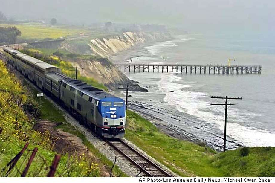 The Coast Starlight train heads north along the Santa Barbara, Calif., coastline in this photo taken March 9, 2005. (AP Photo/Los Angeles Daily News, Michael Owen Baker) Photo: MICHAEL OWEN BAKER
