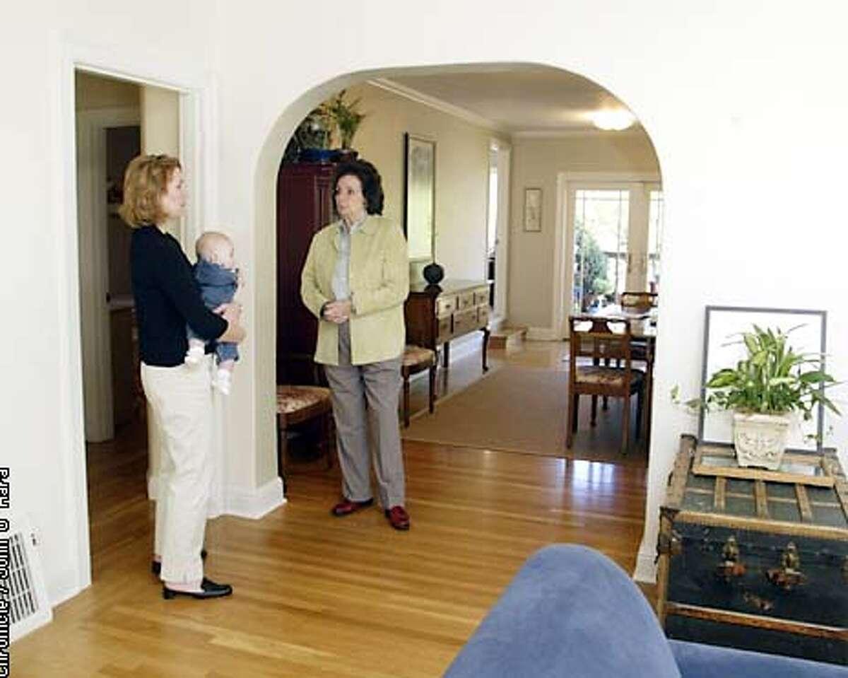 Open House, #41 Jewell St. San rafael,Ca. Kristy McDowell (son Davis, 5 mo.) talk to realator, Marie Whitmore while looking at a 675K house. photo/John O'Hara