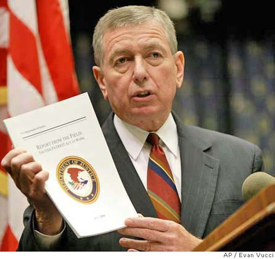 "** FILE ** US Attorney General John Ashcroft holds up a copy of ""Report from the Field: The USA Patriot Act at Work"" during a news conference on July 13, 2004 in Washington. Ashcroft is likely to leave his post before the start of President Bush's second term, senior aides said Thursday Nov. 4, 2004. (AP Photo/Evan Vucci) Ran on: 11-05-2004  John Ashcroft is described as exhausted from fighting the domestic war on terrorism. Ran on: 11-14-2004 Photo: EVAN VUCCI"