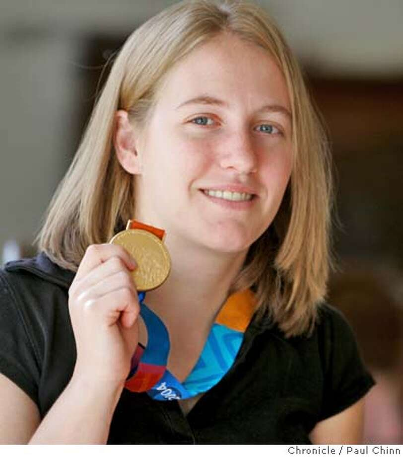 howitt_008_pc.jpg Jennifer Howitt holds up her Olympic gold medal at her Orinda home. Paralympian Jennifer Howitt, 22, has made a name for herself as a basketball gold medalist in Athens and a role model for girls in the 13 years since a hiking accident left her paralyzed from the waist down. Now she starts and entirely new chapter in her life - as a Rhodes Scholar. Photographed on 11/24/04 in Orinda, CA. PAUL CHINN/The Chronicle MANDATORY CREDIT FOR PHOTOG AND S.F. CHRONICLE/ - MAGS OUT Metro#Metro#Chronicle#11/28/2004#ALL#5star##0422484707 Photo: PAUL CHINN
