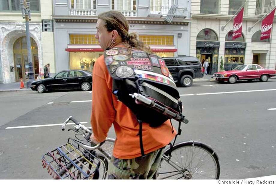Photo by Katy Raddatz--The Chronicle  Three bicycle messengers review messenger-style bags at Saks Men's Store, Coach, and other places. SHOWN: Damon Votour parks his bike on Stockton St. Peter Hartlaub is the reporter. Photo: KATY RADDATZ