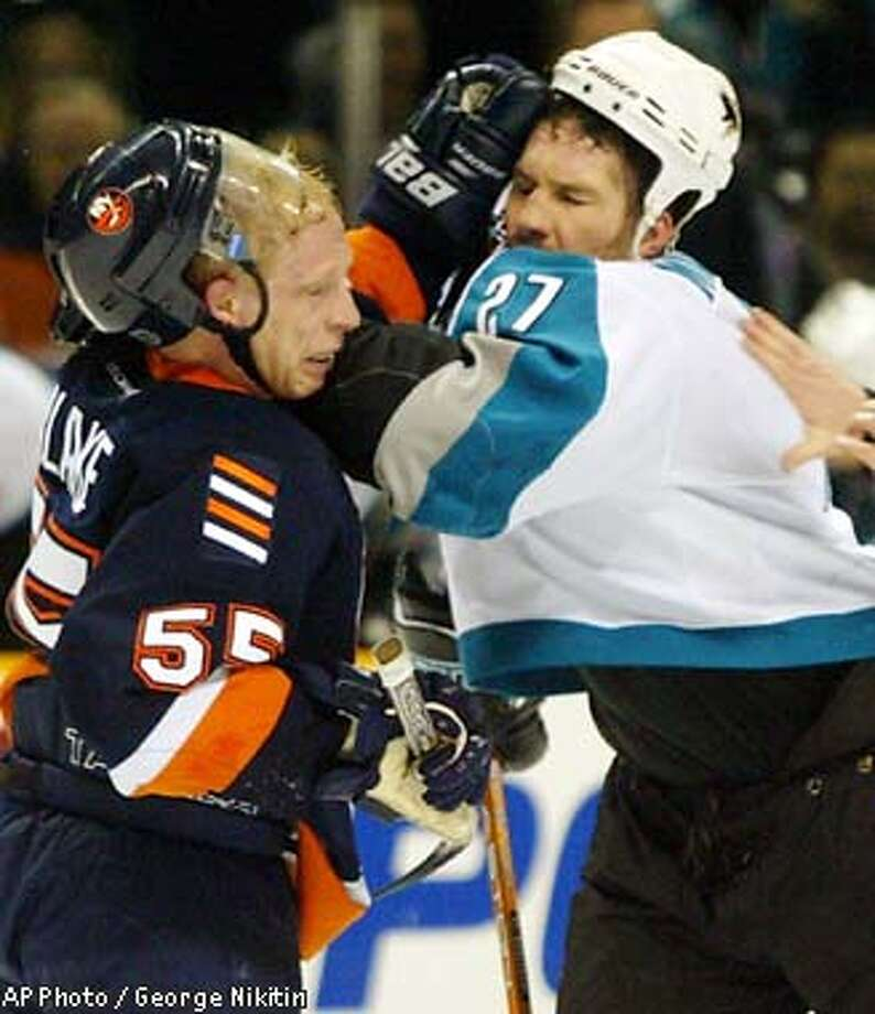 New York Islanders' Jason Blake, left, and San Jose Sharks Bryan Marchment scuffle in the first period Wednesday Feb 19, 2003, at HP Pavilion in San Jose, Calif. (AP Photo/George Nikitin) Photo: GEORGE NIKITIN