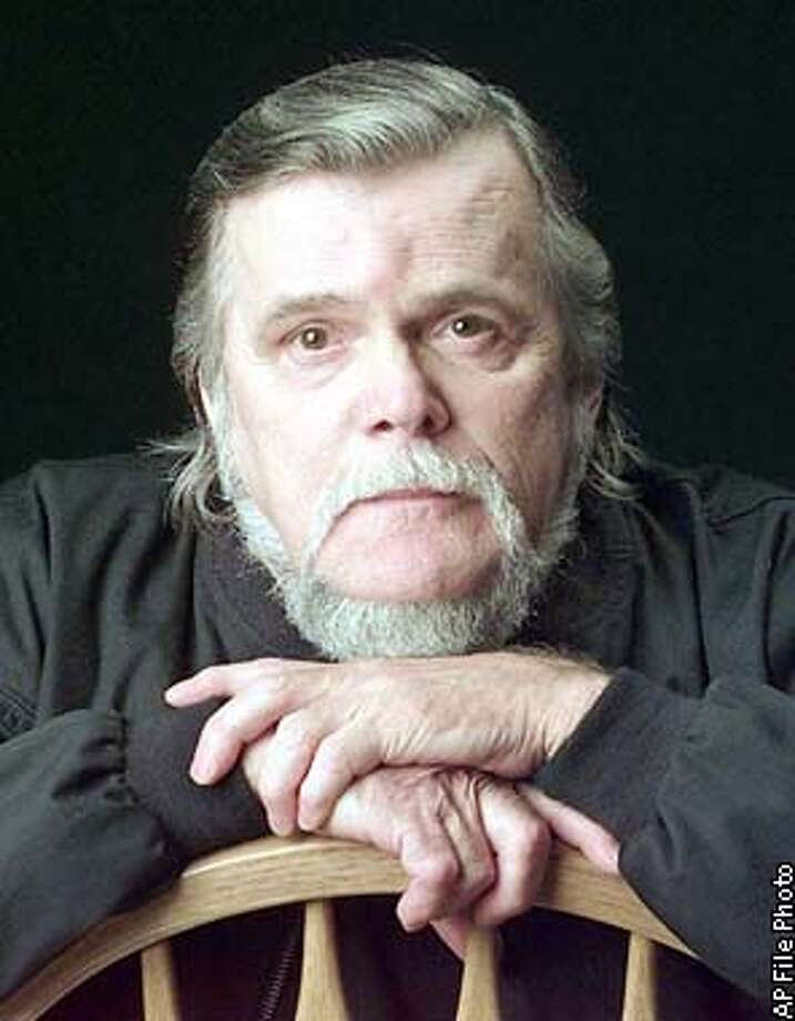"** FILE ** Country singer Johnny PayCheck is seen during an interview Oct. 27, 1997, in Nashville, Tenn. PayCheck, best known for his 1977 working man's anthem ""Take This Job and Shove It,"" died Tuesday, Feb. 18, 2003, Grand Ole Opry spokeswoman Jessie Schmidt said. PayCheck had been bedridden in a nursing home because of emphysema and asthma. He was 64. (AP Photo/Mark Humphrey, File) Photo: MARK HUMPHREY"