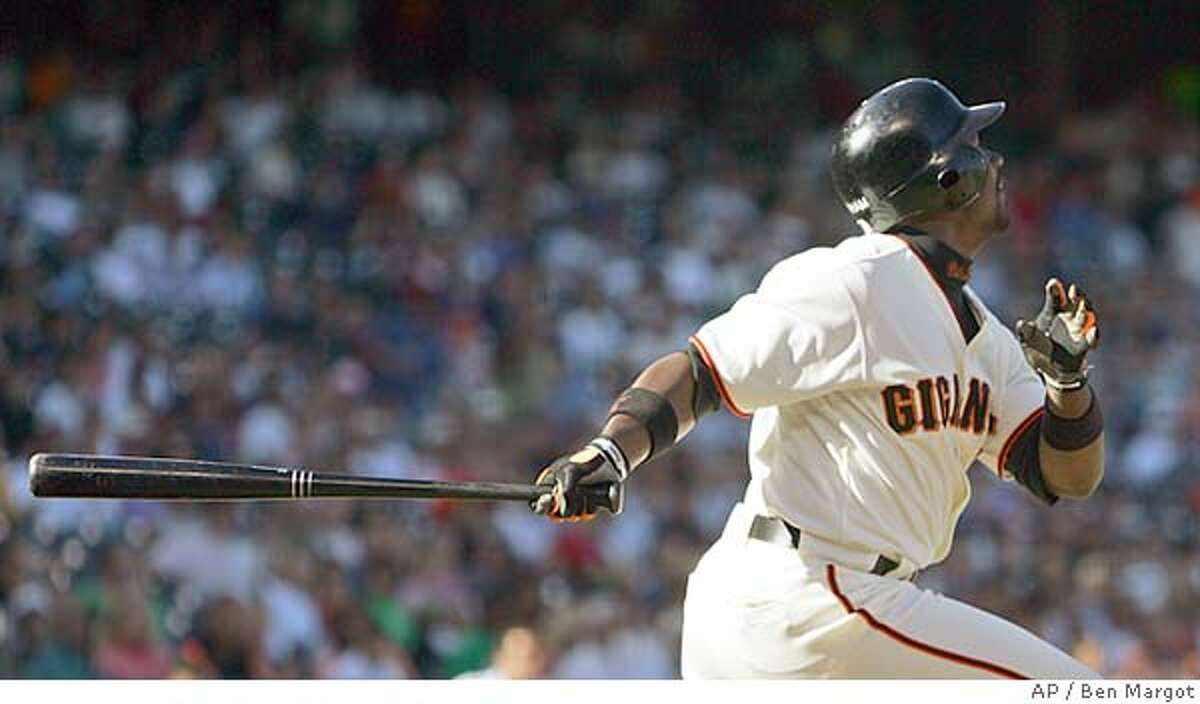 San Francisco Giants' Ray Durham swings for an RBI sacrifice fly off Oakland Athletics' Dan Haren in the first inning Saturday, May 21, 2005, in San Francisco. Durham extended his club-best hitting streak to 12 games, as the San Francisco Giants defeated the Oakland Athletics 3-2. (AP Photo/Ben Margot)