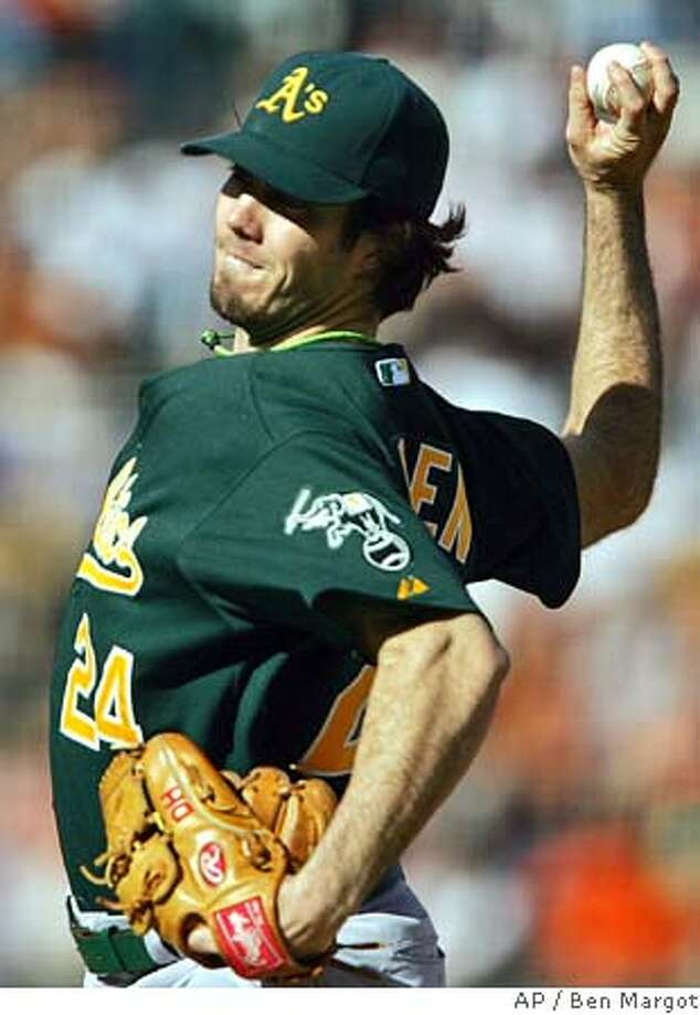 Oakland Athletics' Dan Haren works against the San Francisco Giants in the first inning Saturday, May 21, 2005, in San Francisco. (AP Photo/Ben Margot) Photo: BEN MARGOT
