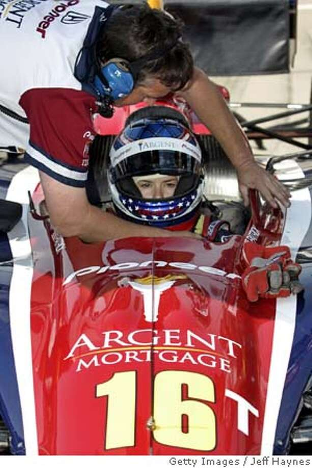 Rookie female driver Danica Patrick of the US is helped into her car 18 May, 2005 during practice for the Indianapolis 500 at the Indianapolis Motor Speedway in Indianapolis, Indiana. Starting fourth Patrick will be the highest starting female driver in the 89 year histroy of the Indianapolis 500 which will be held on 29 May, 2005. AFP PHOTO/JEFF HAYNES (Photo credit should read JEFF HAYNES/AFP/Getty Images) Photo: JEFF HAYNES