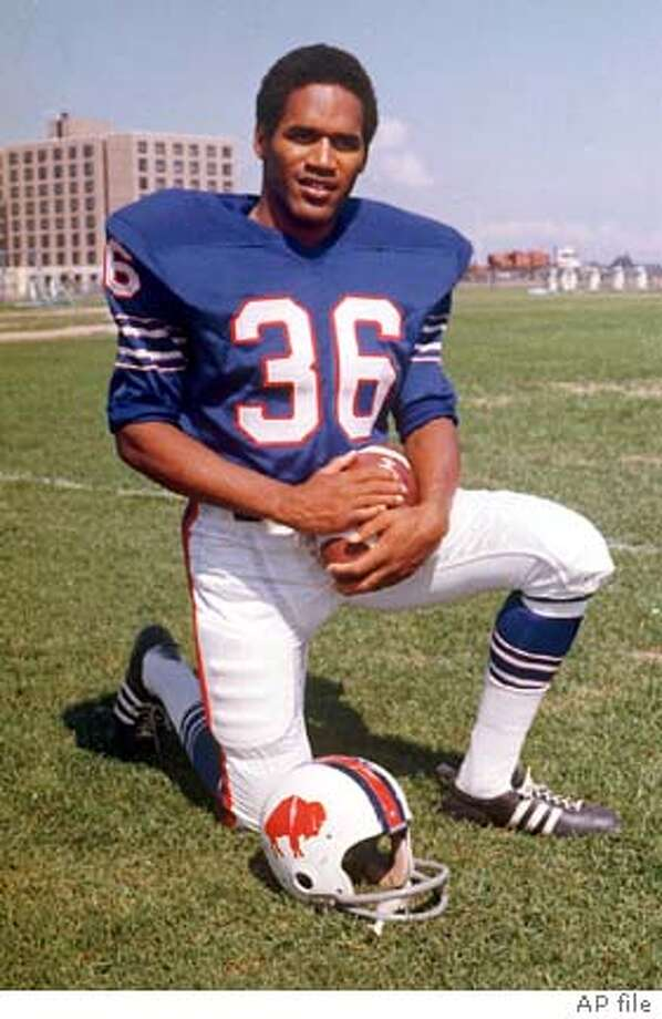 FILE--O.J. Simpson poses in his Buffalo Bills uniform in this 1973 file photo. Simpson's triumphs as a football hero on and off the field are far removed from his appearances as a defendant in a Los Angeles courtroom where he is scheduled to go on trial for murder Sept. 26.(AP Photo/file)
