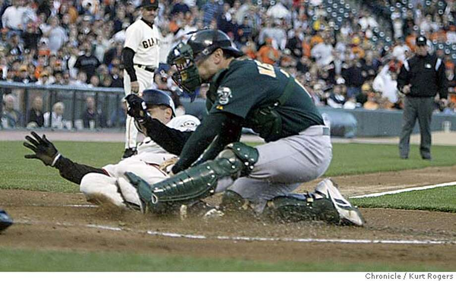 Omar Vizquel is taged out out at the plate by Jason Kindall in the first inning  The Oakland Athletics Vs. San Francisco Giants. 5/20/05 in San Francisco,CA.  KURT ROGERS/THE CHRONICLE Photo: KURT ROGERS