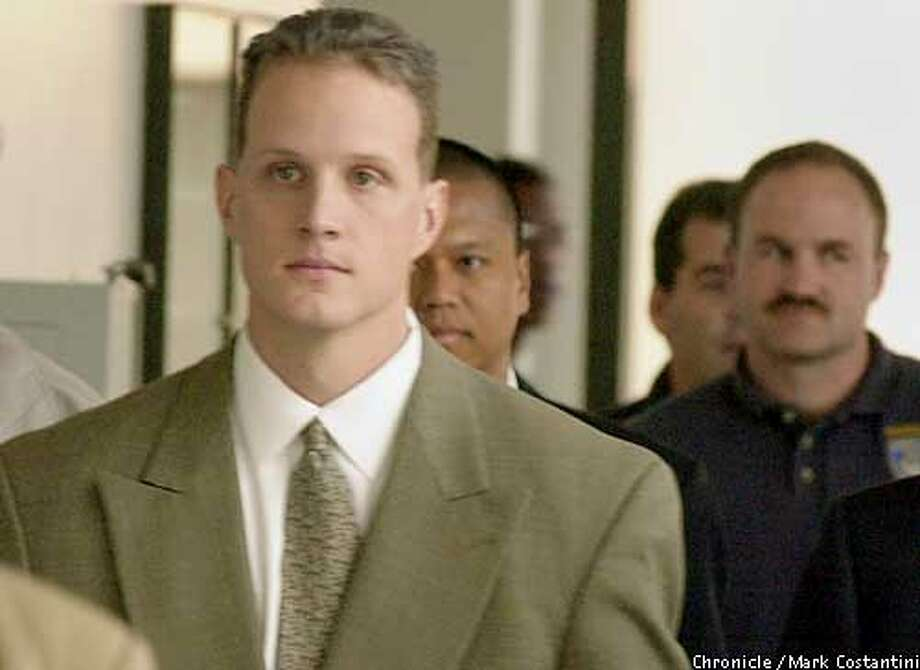 "RIDERS07b-C-06DEC00-EZ-MC. Matt Hornung, an Oakland cop and part of a group known as ""The Riders,"" leaves Alameda County Superior Court in Oakland today. Photo by Mark Costantini/Chronicle ALSO RAN 5/31/2001"
