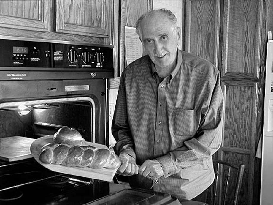 Murray Jaffe takes a loaf of bread out of an oven. Photo: Brock Palmer