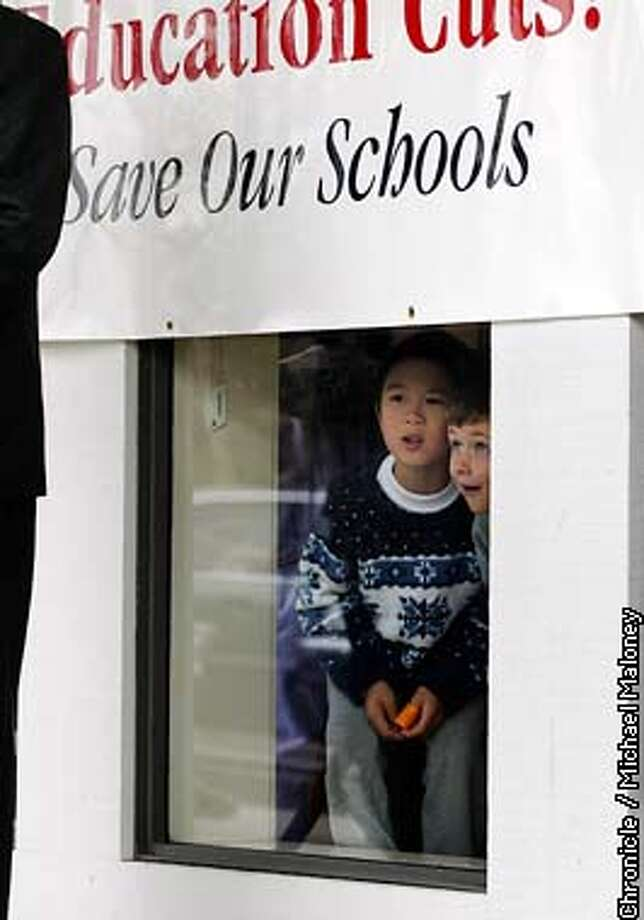 """TREASURER2-C-13FEB03-MT-MJM  Schools kids look out at the press conference under a """"Save Our Schools"""" banner.  State Treasurer Phil Angelides held a press conference outside Danville's Sycamore Valley Elementary School launching a statewide drive to save school funding from budget cuts. With him were a small group of educaters and parents.  CHRONICLE PHOTO BY MICHAEL MALONEY Photo: MICHAEL MALONEY"""
