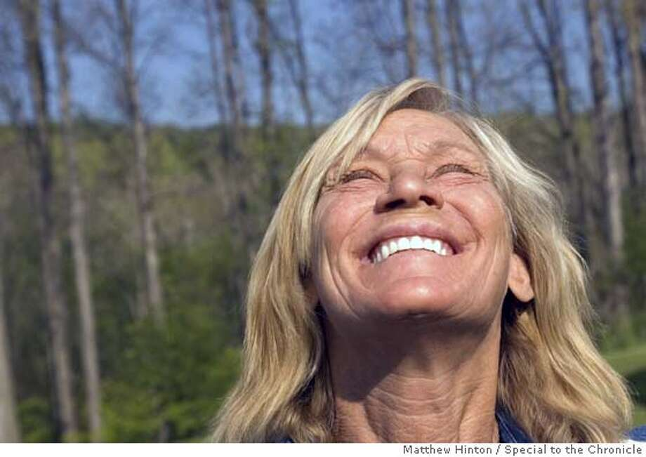 Rita Grant, 54, soaks up the morning sun at Alice Wells� home in Lansing, New York, on Wednesday, May 18, 2005. Wells has been a friend of Grant�s since high school in Brewster, New York. Grant recently received a new set of dentures from dentists who read about her recovery from homelessness and drug addiction.  Matthew Hinton/Special to the Chronicle Photo: Matthew Hinton/Special To The Ch