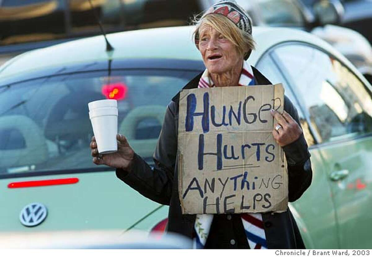 Rita panhandles in the traffic on South Van Ness Avenue in 2003. Rita Grant was homeless in San Francisco for years. She used to hang out at the traffic island at South Van Ness and Mission Streets. Now she has gone home to her family in Florida where she recently had her teeth removed and dentures made. Brant Ward 8/15/03