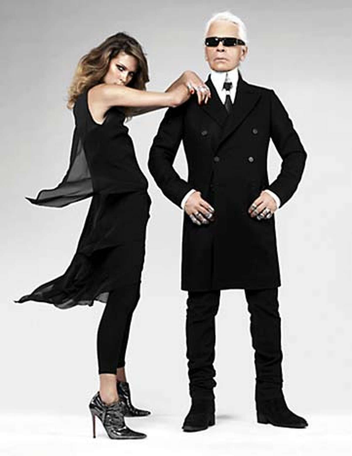 Karl lagerfeld and model show off his new line for the fast-fashion retailer, H&M. HANDOUT Living#Living#Chronicle#11/21/2004#ALL#Advance#M6#0422470070