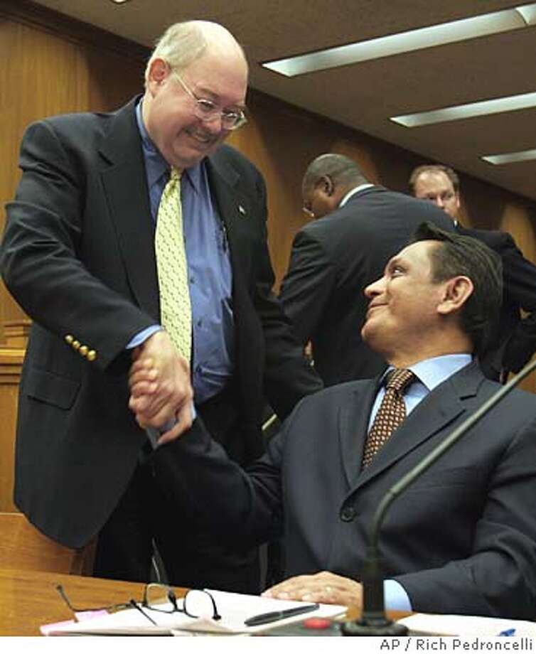 Sen. Gil Cedillo, D-Los Angeles, right, shakes hands with Rick Oltman, of the Federation for Immigration Reform, after Oltman testified against Cedillo's measure to allow illegal immigrants to get a California driver's license, during a Senate committee hearing at the Capitol in Sacramento, Calif., Thursday, May 19, 2005. The Senate Transportation Committee approved Cedillo's bill by an 8-5 vote, sending it to the Senate Appropriations Committee. (AP Photo/Rich Pedroncelli) Photo: RICH PEDRONCELLI