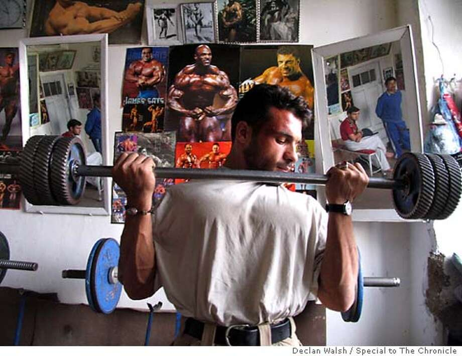 Weightlifting enthusiast at Aziz Arzo's gym in Kabul, Afghanistan. Oct 2004. By Declan Walsh