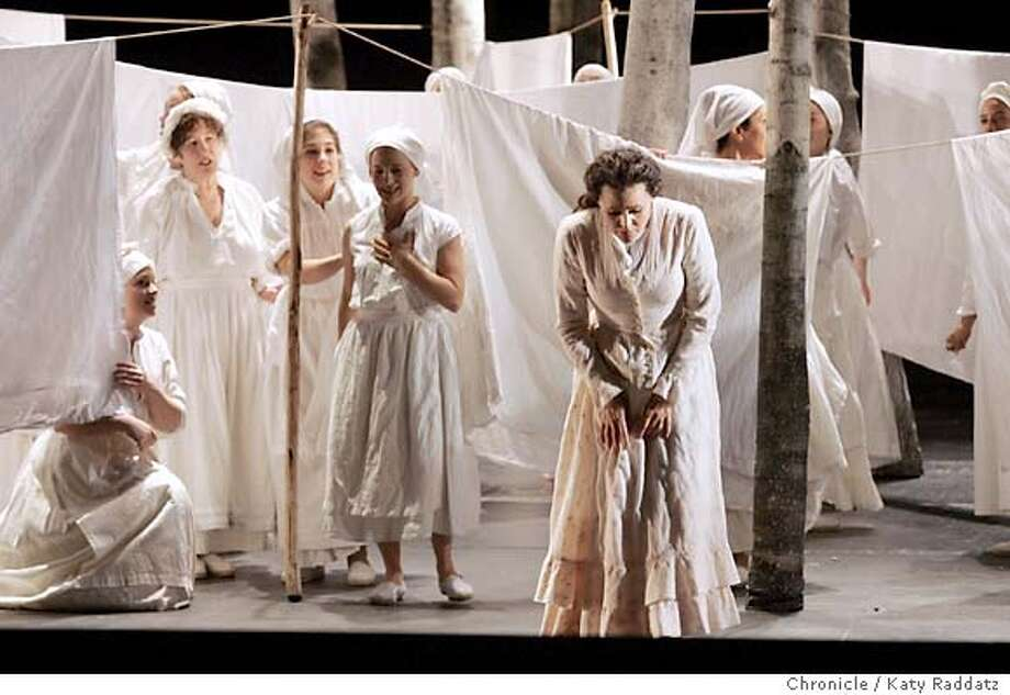 "ONEGIN_rad.jpg San Fraqncisco Opera presents Tchaikovsky's ""Eugene Onegin."" SHOWN: Tatiana is in the foreground, regretting the love letter she sent to Onegin, while the women of the chorus do the wash. Katy Raddatz / The Chronicle Photo: Katy Raddatz"
