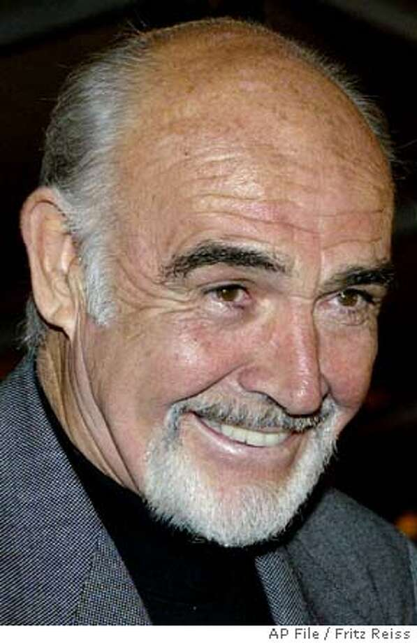 "**FILE**Actor Sean Connery smiles prior to the premiere in Germany of his movie ""The League of Extraordinary Gentlemen"" in Berlin, in this Sept. 30, 2003 photo. Adding his voice to a campaign against global hunger, Connery is to appear in a holiday-season television ad to promote the work of a United Nations food agency. In the commercial for the World Food Program, the Scottish-born actor delivers a message following footage that shows how the agency sends food to hungry people in remote areas around the world. International broadcasters including BBC World have agreed to air the ad over the Christmas period, the Rome-based agency said Tuesday,Dec. 16,2003, (AP Photo/Fritz Reiss,file) A SEPT 30 2003 FILE PHOTO Photo: FRITZ REISS"