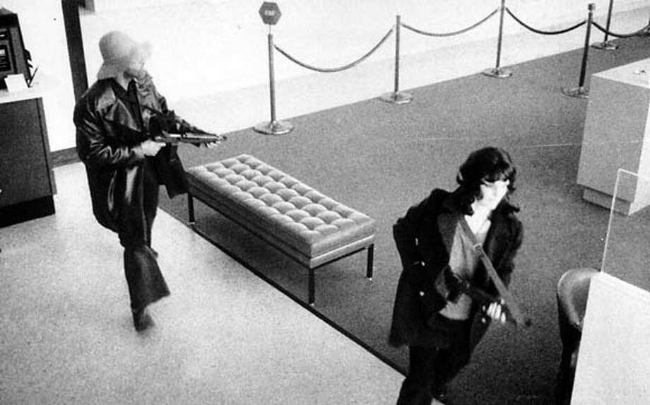 Donald DeFreeze and Patty Hearst leaving the Hibernia Bank in San Francisco April 15, 1974.