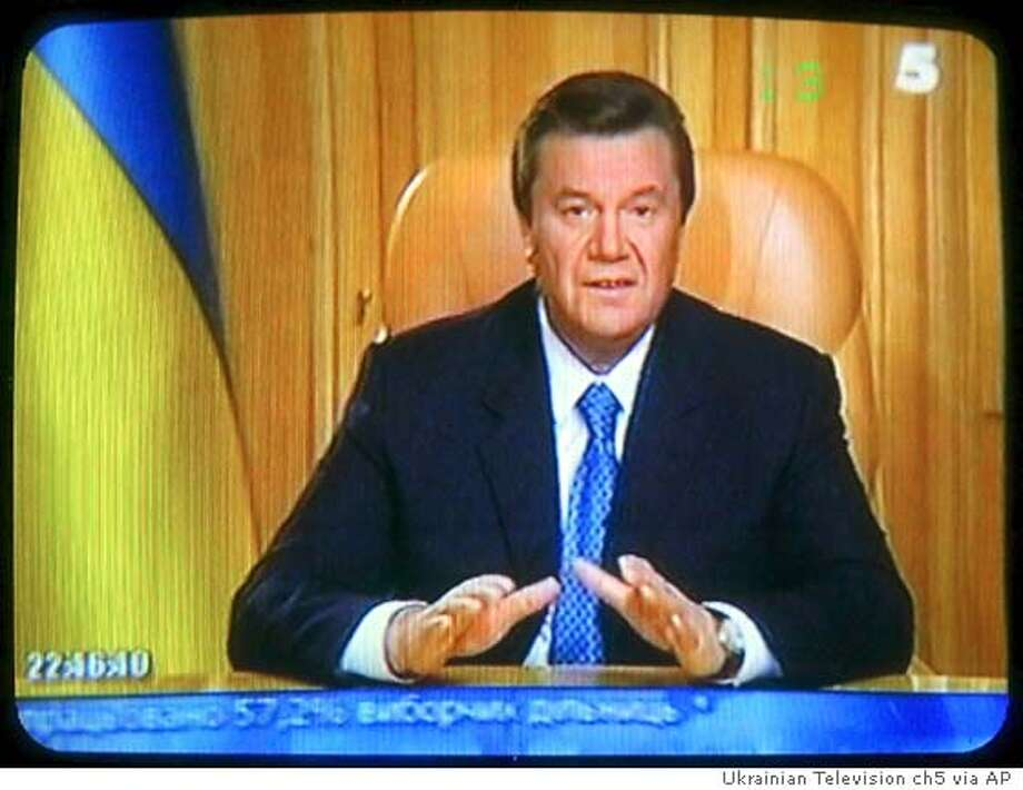 "In this image taken from Ukrainian Television channel 5 (five) shows Prime Minister Viktor Yanukovych seen addressing to The Nation in Kiev, Monday, Nov. 22, 2004. Yanukovich, in televised comments, called for national unity and said ""I categorically will not accept the actions of certain politicians who are now calling people to the barricades. This small group of radicals has taken upon itself the goal of splitting Ukraine."" The Ukrainian Election Commission's announcement that the Kremlin-backed Prime Minister Viktor Yanukovych was ahead of reformist candidate Viktor Yushchenko with nearly all the votes counted galvanized widespread dismay and anger among the former Soviet republic's 48 million people. (AP Photo/Ukrainian Television channel 5) ** TV OUT ** Ran on: 11-24-2004  Viktor Yushchenko asserts his victory as he walks the street en route to the Ukrainian presidential administration building in Kiev. Ran on: 11-24-2004  Viktor Yushchenko asserts his victory as he walks the street en route to the Ukrainian presidential administration building in Kiev."