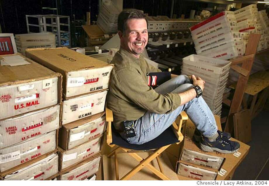NETFLIX008.JPG  Reed Hastings, Netflix's chief executive sits among boxes filled with DVDs that are being mailed out to customers, Tuesday March 2 , 2004, in San Jose Event on 3/2/04 in SAN JOSE. LACY ATKINS / The Chronicle Netflix envelopes go along a conveyor belt, above, at the company's San Jose distribution center. Reed Hastings, left, gambled on the new DVD format when he founded Netflix in 1997. Ran on: 01-13-2005  Reed Hastings couldn't muster enough votes from the Senate Rules Committee. MANDATORY CREDIT FOR PHOTOG AND SF CHRONICLE/ -MAGS OUT Photo: LACY ATKINS
