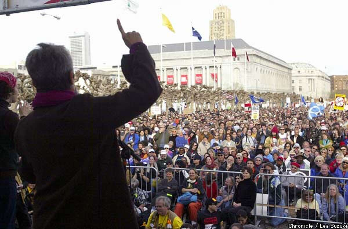Joan Baez exhorted the crowd at Civic Center Plaza after a march from the Ferry Building sunday. By Lea Suzuki/Chronicle