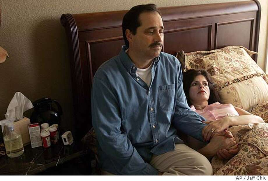 Bob and Carmen Pack are shown in their home in Danville, Calif., Friday, May 13, 2005. The couple whose son and daughter were killed by a nanny with a history of drunk driving convictions, are facing another heart-wrenching loss. Doctors at John Muir Medical Center told the couple, that the twin boys Carmen Pack is carrying are unlikely to survive. (AP Photo/Jeff Chiu) Photo: JEFF CHIU