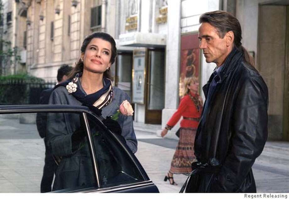 "CALLAS24 Fanny Ardant (as Maria Callas) and Jeremy Irons (as Larry Kelly) stand by her car in the film ""Callas Forever."" REGENT RELEASING  Regent releasing Datebook#Datebook#Chronicle#11/24/2004##Advance##0422480635"