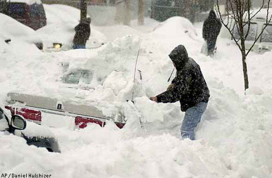 Martin Capto, of Newark, N.J., shovels his car out from a large snow drift in Newark, N.J., Monday, Feb. 17, 2003. (AP Photo/Daniel Hulshizer) Photo: DANIEL HULSHIZER