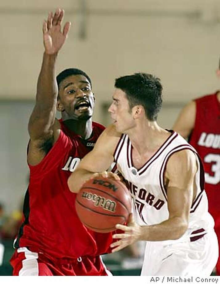 Louisville's Taquan Dean, left, defends Stanford's Chris Hernandez during the second half in a game for fifth place in the Maui Invitational in Lahaina, Hawaii, Wednesday, Nov. 24, 2004. Dean scored 30 as Louisville defeated Stanford 82-67. (AP Photo/Michael Conroy) DEAN HERNANDEZ Sports#Sports#Chronicle#11/25/2004#ALL#5star##0422484285 Photo: MICHAEL CONROY