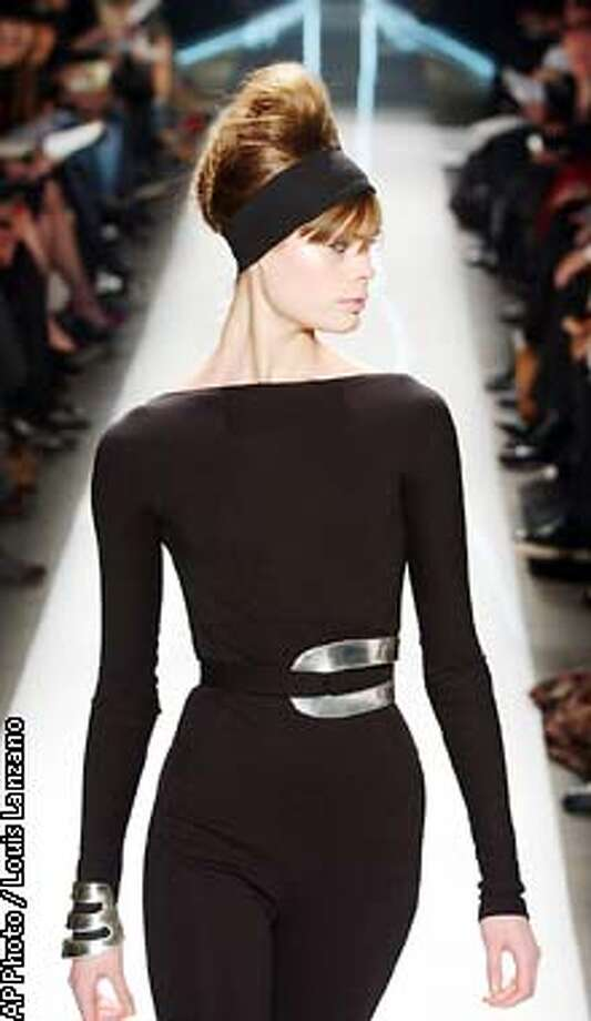 A model wears a black stretch wool double-knit jumpsuit at the Donna Karan fall 2003 fashion show in New York, Friday, Feb.14, 2003. (AP Photo / Louis Lanzano) Photo: LOUIS LANZANO