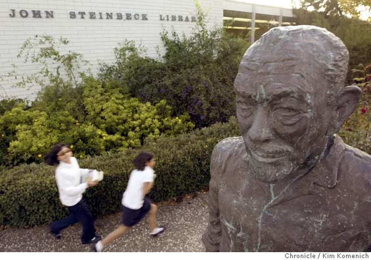 Kiddos run past the statue of Nobel Prize novelist John Steinbeck on the front lawn of the Salinas Main Library. Voters turned down measures that would have kept the financially stressed Salinas libraries open. Consequently, the libraries are scheduled to close after the first of the year unless the public finds a way to keep them open. Photo by Kim Komenich in Salinas.