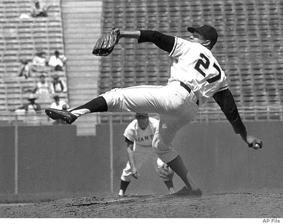 San Francisco Giants' righthander, Juan Marichal, who made his first start in Candlestick Park today, September 9, 1965, since his battle August 22 with John Roseboro of the Los Angeles Dodgers, goes high with his left foot in his usual wind up form on the mound against the Houston Astros. Marichal notched his tenth shutout and his 21st victory of the season. Fans cheered when he started his pregame warmup and again when he faced the first Houston batter. San Francisco won 4 to 0. (AP Photo) ALSO RAN: 3/31/2000 (SPECIAL PREVIEW SECTION: BASEBALL `00) CAT Photo: RHH
