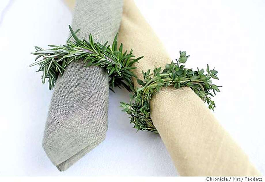 NAPKIN24_rad.jpg Story is about last minute Thanksgiving table settings. SHOWN: napkin rings of fresh herbs. L to R: rosemary napkin ring, thyme napkin ring. On rolled linen napkins. Katy Raddatz / The Chronicle Ran on: 11-21-2004 Photo: Katy Raddatz