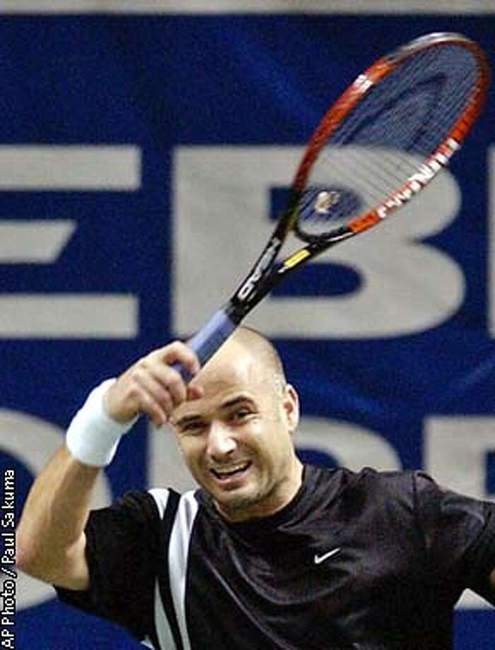 Top-seeded Andre Agassi returns a shot to Davide Sanguinetti in the finals of the in San Jose, Calif., Sunday, Feb. 16, 2003. (AP Photo/Paul Sakuma) Photo: PAUL SAKUMA