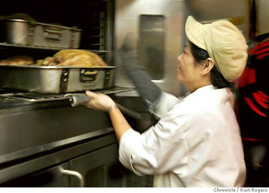 Lien Do Looks at some of the 300 turkeys that St. Anthony Foundation in San Francisco is cooking for Thanksgiving. GIVING24_1043_kr.JPG 11/23/04 in San Francisco,CA.  KURT ROGERS/THE CHRONICLE MANDATORY CREDIT FOR PHOTOG AND SF CHRONICLE/ -MAGS OUT Metro#Metro#Chronicle#11/24/2004#ALL#5star##0422482793 Photo: KURT ROGERS