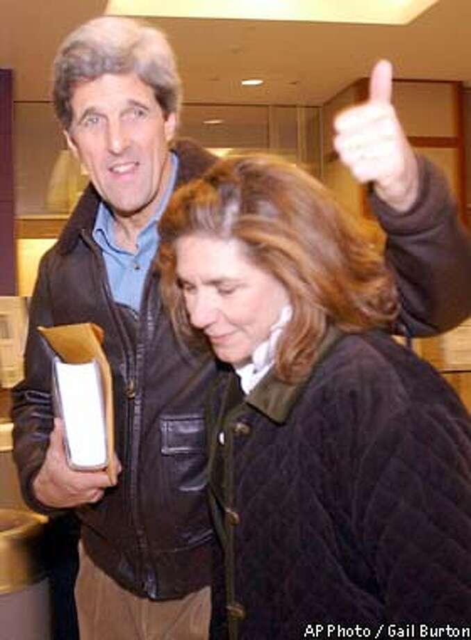 Sen. John F. Kerry, D-Mass., accompanied by his wife Teresa, gives a thumbs up as he walks through the lobby of Johns Hopkins Hospital Wed., Feb. 12, 2003 in Baltimore. Kerry is to have surgery today for prostate cancer. (AP Photo / Gail Burton) Photo: GAIL BURTON