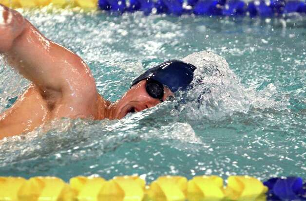 Darien's James Baker competes in the 500 Freestyle during the boys swim meet against Westhill-Stamford co-op at the Darien YMCA on Wednesday, Jan. 18, 2012. Photo: Amy Mortensen / Connecticut Post Freelance