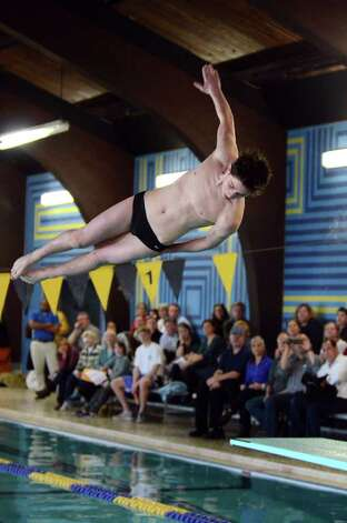 Westhill-Stamford co-op's Ben Coyman competes during the boys diving meet against Darien at the Darien YMCA on Wednesday, Jan. 18, 2012. Photo: Amy Mortensen / Connecticut Post Freelance