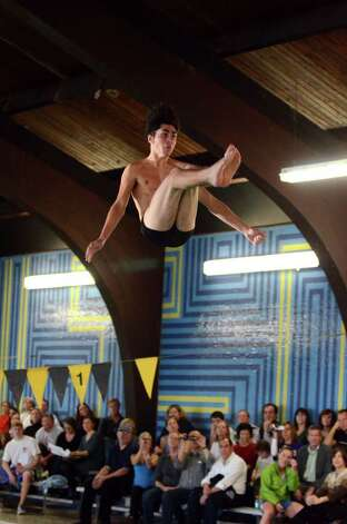 Westhill-Stamford co-op's Robbie Katz competes during the boys diving meet against Darien at the Darien YMCA on Wednesday, Jan. 18, 2012. Photo: Amy Mortensen / Connecticut Post Freelance
