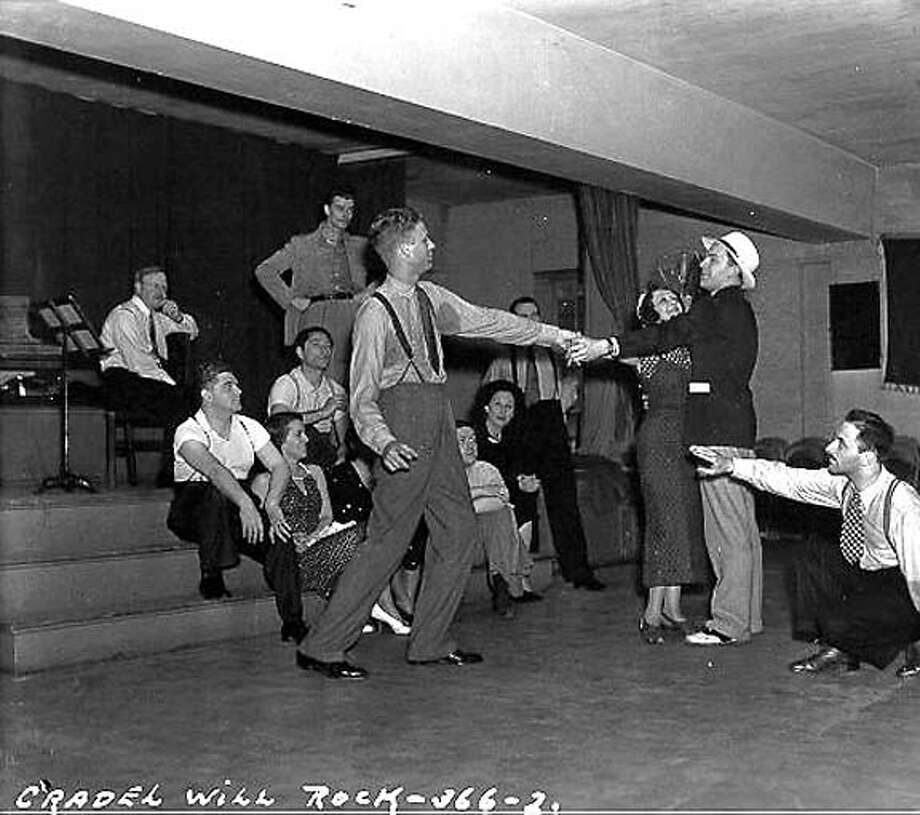 "Orson Welles and cast rehearse ""The Cradle Will Rock."""