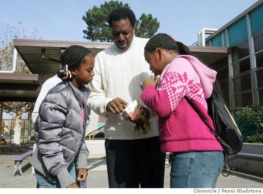 "OAKSKULS19062PG.JPG  teacher Jeffery Taylor goes over nutrition facts from a ""cup of soup"" with Joyceann Levy age 12, Roneisha Smith age 11.  the oakland school district is going to close more schools next year. lowell middle school is/may be on the chopping block, and parents, students, alumni, teachers are angry. we go talk to people.  Photo taken by Penni Gladstone/The San Francisco Chronicle  Photo taken on 11/19/04, in Oakland, CA. Metro#Metro#Chronicle#11/19/2004#ALL#5star##0422474051 Photo: Penni Gladstone"