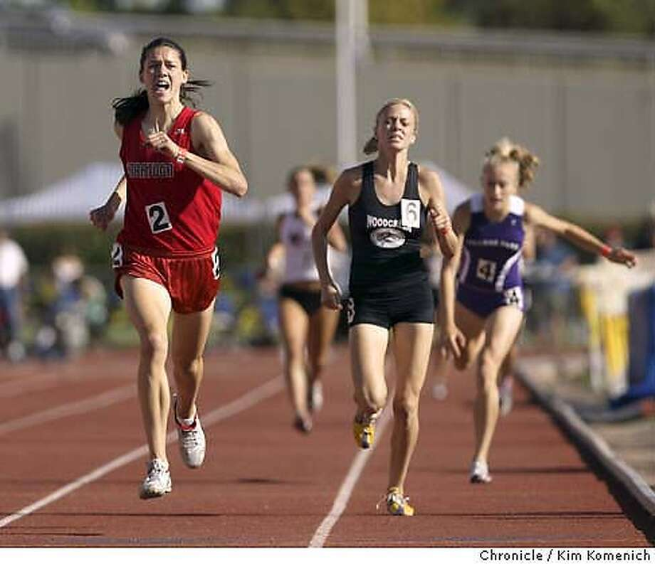 Alicia Follmar (left) of Saratoga takes first in the Girls 1600 meter run, followed by Lauren Mulkey of Woodcreek (center). At right is Lindsay Allen of College Park who lost her footing in the final seconds. Bay Area athletes compete in the California Interscholastic Federation State Track and Field Championships at Sacramento City College.  Photo by Kim Komenich in Sacramento. Photo: Kim Komenich