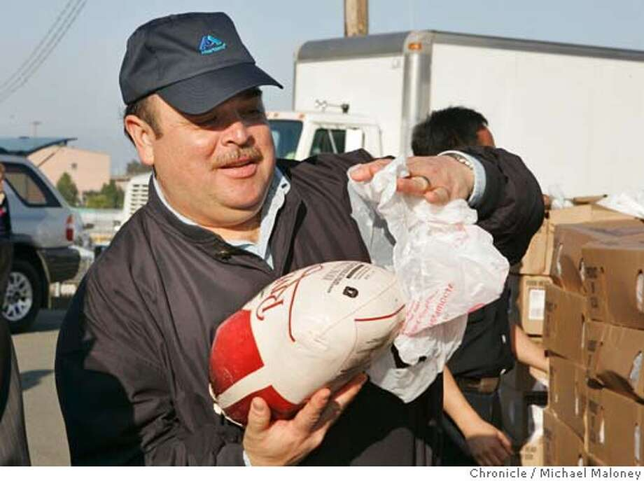 "TURKEY19_002_MJM.jpg  Lt Governor Cruz M. Bustamante unwraps a frozen turkey to check it out - one of hundreds given away.  Lt Governor Cruz M. Bustamante partnered with the San Francisco Food Bank to provide hundreds of SF families with free Thanksgiving turkey as part of his annual ""Operation Gobble"" program. The distribution of 1,500 turkeys to agencies serving low-income San Franciscans took place at the SF Food Bank this afternoon. For the past 11 years, Bustamante has brought together corporate sponsors and volunteers for ""Operation Gobble"". This year's sponsors include Albertson's and Bank of America Private Bank. SF firefighters were also on hand to help load the turkeys into various agency cars and trucks.  Photo by Michael Maloney / San Francisco Chronicle MANDATORY CREDIT FOR PHOTOG AND SF CHRONICLE/ -MAGS OUT Metro#Metro#Chronicle#11/19/2004#ALL#5star##0422474126 Photo: Michael Maloney"